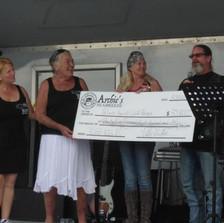 Patty presenting check $38,000 raised