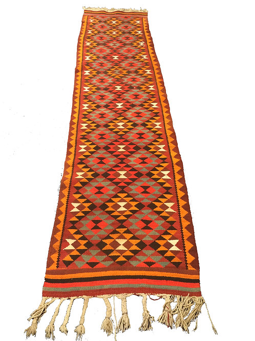 Triangle patterned extra long woven rug