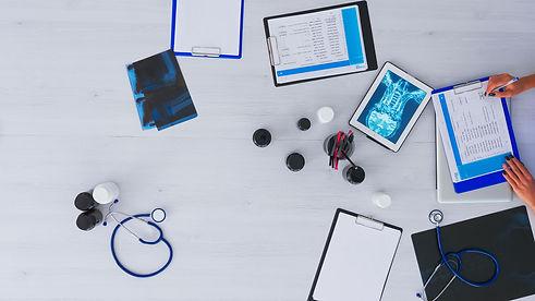 doctor-checking-medical-record-on-desktop-top-view-WDTDNMQ.jpg