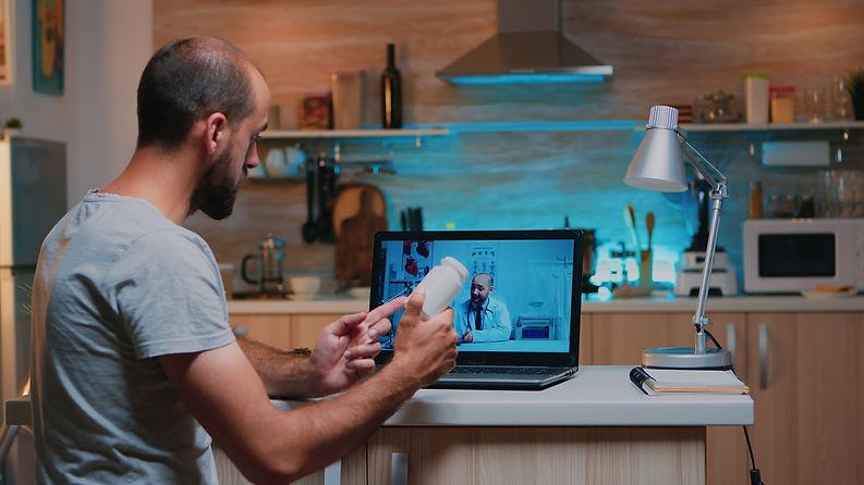doctor-videoconferencing-remote-man-patient-consul-X4FWLGP.jpg