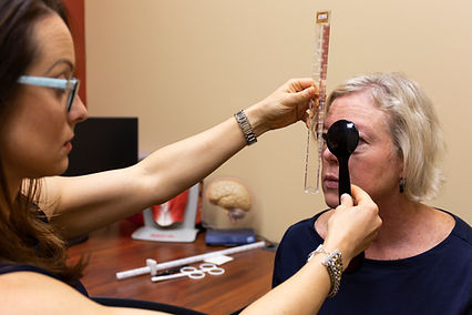 A woman being tested to see if she has a strabismus or lazy eye in Richmond, VA
