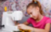 Kid sewing.png