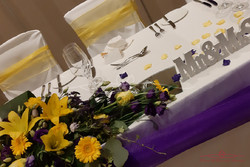 Yellow and purple table decor
