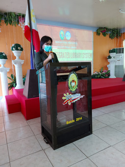 Ms. Gina D. Belarma as she gave her message.