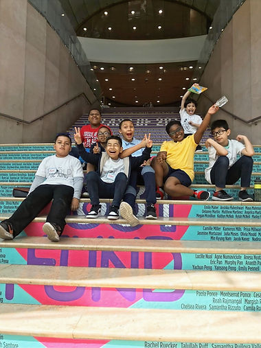 Horizon students on class trip posing on stairs