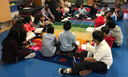 Children active listening in a circle in The Exploration Center