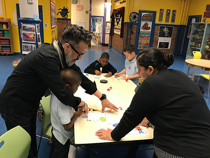 Teachers working with children in The Exploration Center