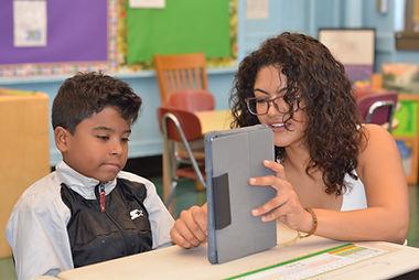 teacher showing student ipad