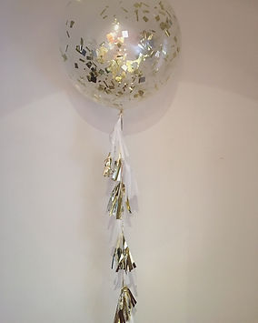 The Little Balloonery. Giant gold confetti balloon. Tassel garland