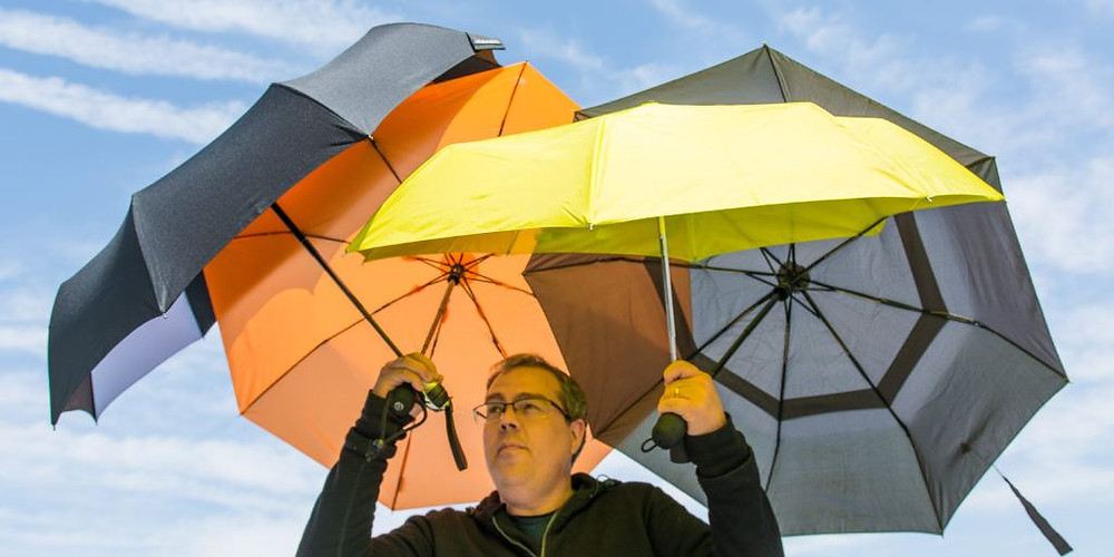 Man Holding Umbrella to Protect Himself from Ultraviolet Rays Photo cr: Michael Hession