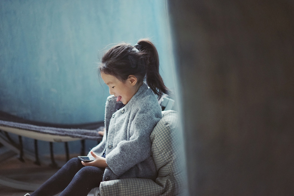 Asian Child Using Digital Devices