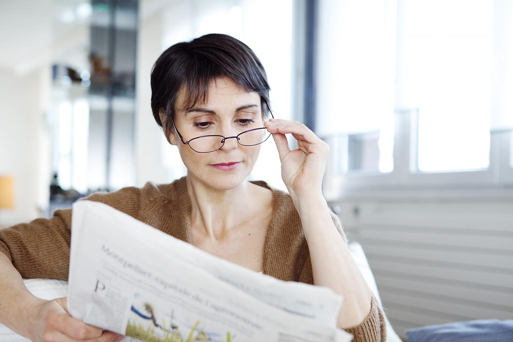 Reading Newspaper With The Aid Of Reading Glasses