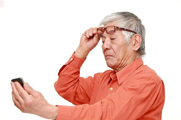 Man Suffering From Presbyopia