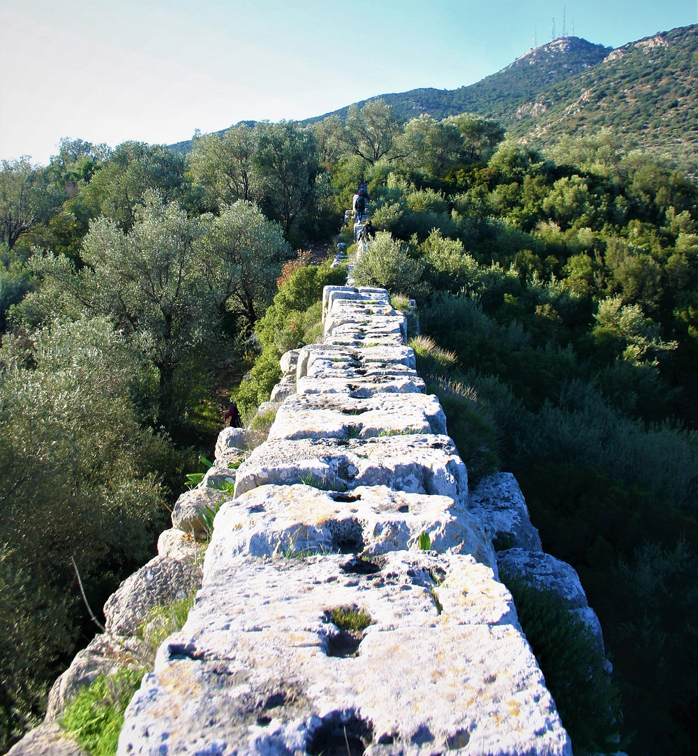 Closeup of the stone pipe of the Delikkemer Aqueduct great for trekking on the lycian way