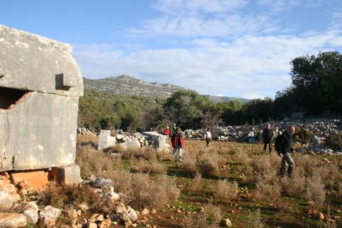 Lycian Sarcophagus and trekking group at Istlada