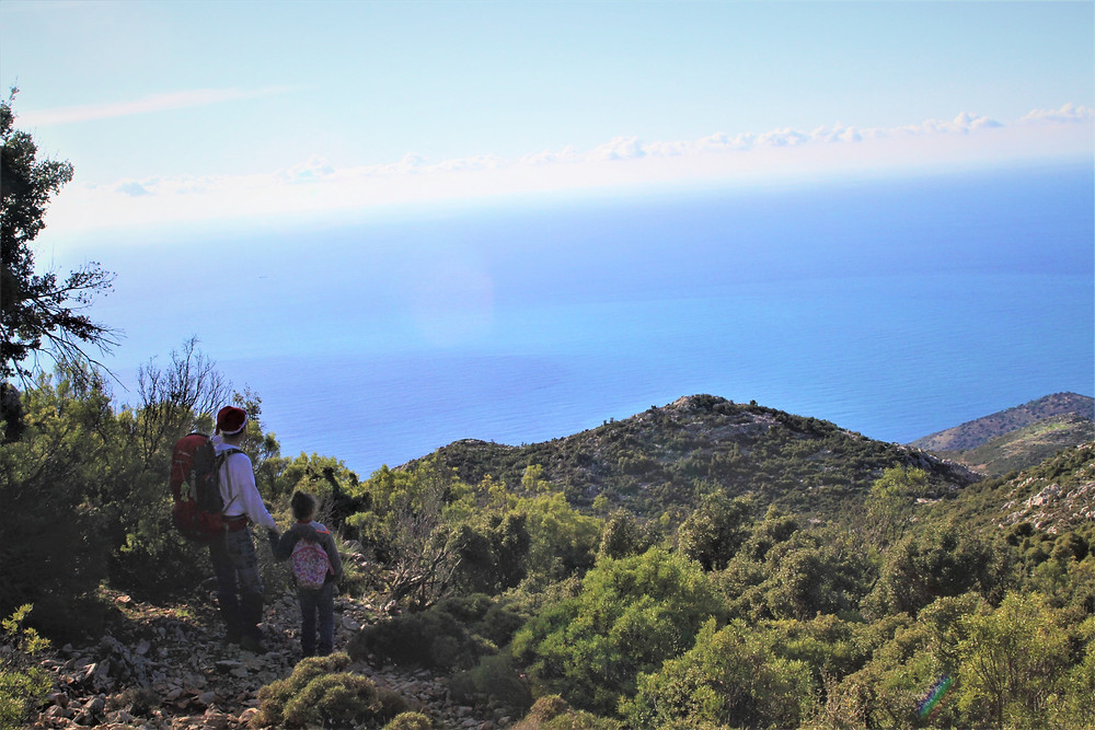 Father and child treking on a section of Lycian footpath before Gey