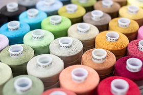 wonderfill konfetti threads a 100% cotton thread in various colours with blured out background