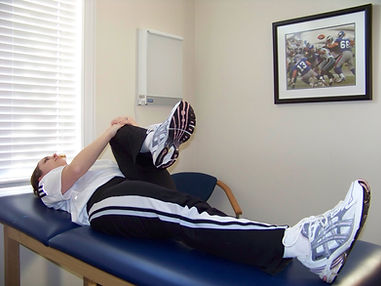 knee_to_chest_back_exercise_new_jersey_sports_medicine.jpg