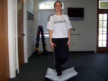 ankle_proprioception_balance_pillow_arms_side_closed_eye_new_jersey_sports_medicine.jpg