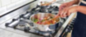 stainless steel and black gas range oven_edited.jpg