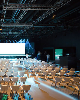 Super conference hall with white chairs