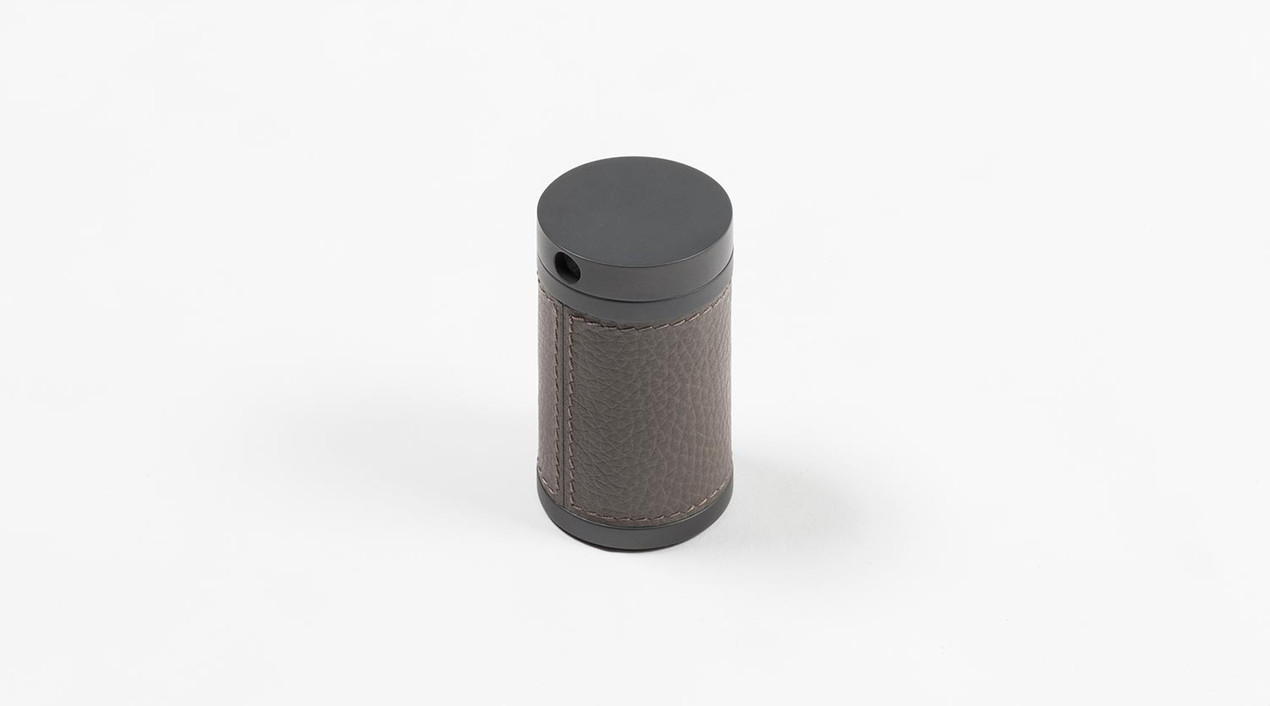 Curzio pencil sharpener in bronze with leather inlay