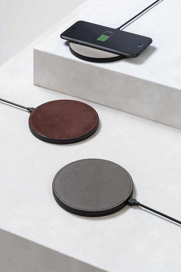 Nick fast Qi-certified wireless charger from GioBagnara with customisable leather or suede surface