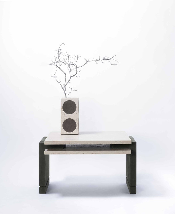 Stratos coffee table, with travertino tabletop and leather-covered legs, designed by Stephane Parmentier for GioBagnara