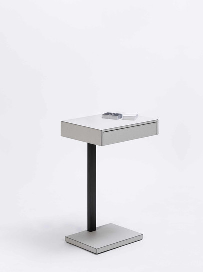 Ernesto side table covered in calfskin leather by GioBagnara