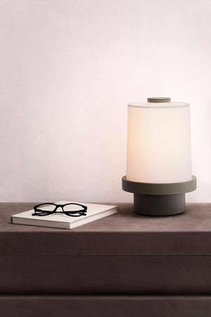 Leather covered table lamp by GioBagnara