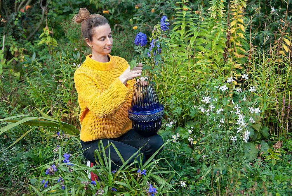 Kiki van Eijk arranging flowers in the Matrice vase designed for Saint-Louis