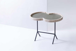 The Eight occassional table with travertino structure and inlaid with Italian suede by GioBagnara