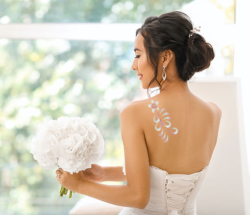 Glitter body art and stencils for brides and formal events. Temporary glitter body art applied with body adhesive. Romantic design orchid and swish. Dusty Rose, Pink, White and Silver body glitter.
