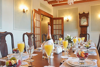 Breakfast table set up for guests at the Manoir Chamberland.