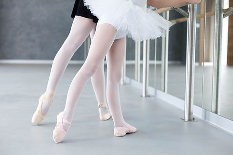 Two ballerinas child girl and woman in b