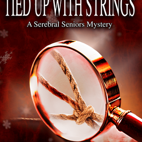 Book Review | Tied Up With Strings by @MadMcEwen #cozymystery #bookreview