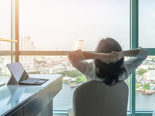 Person Stretching in an Office