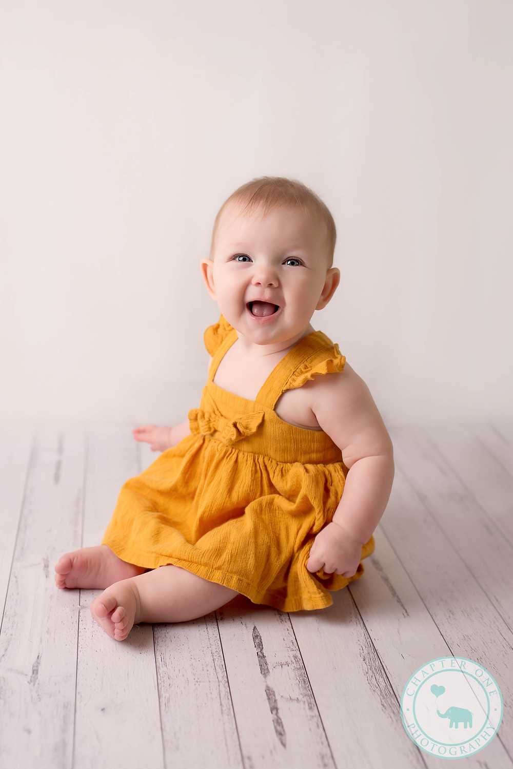 6 month baby girl laughing