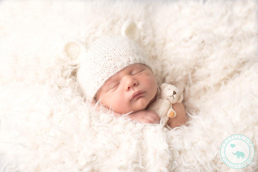 Newborn boy with teddy