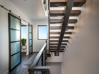 Steel stair system with floating white oak treads.