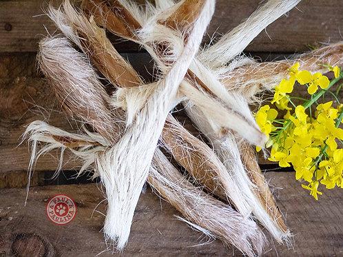 Strisce essiccate di capra con pelo