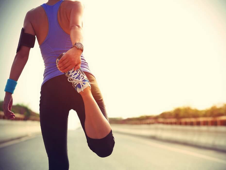 Woman Runner Stretching Legs