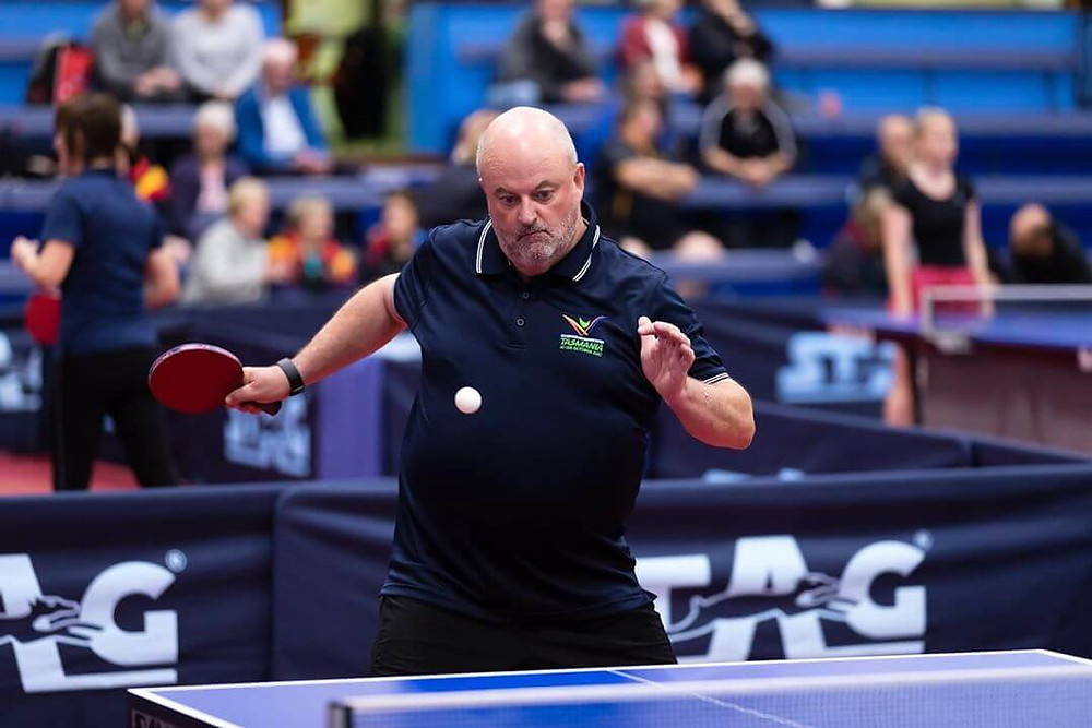 A man playing table tennis