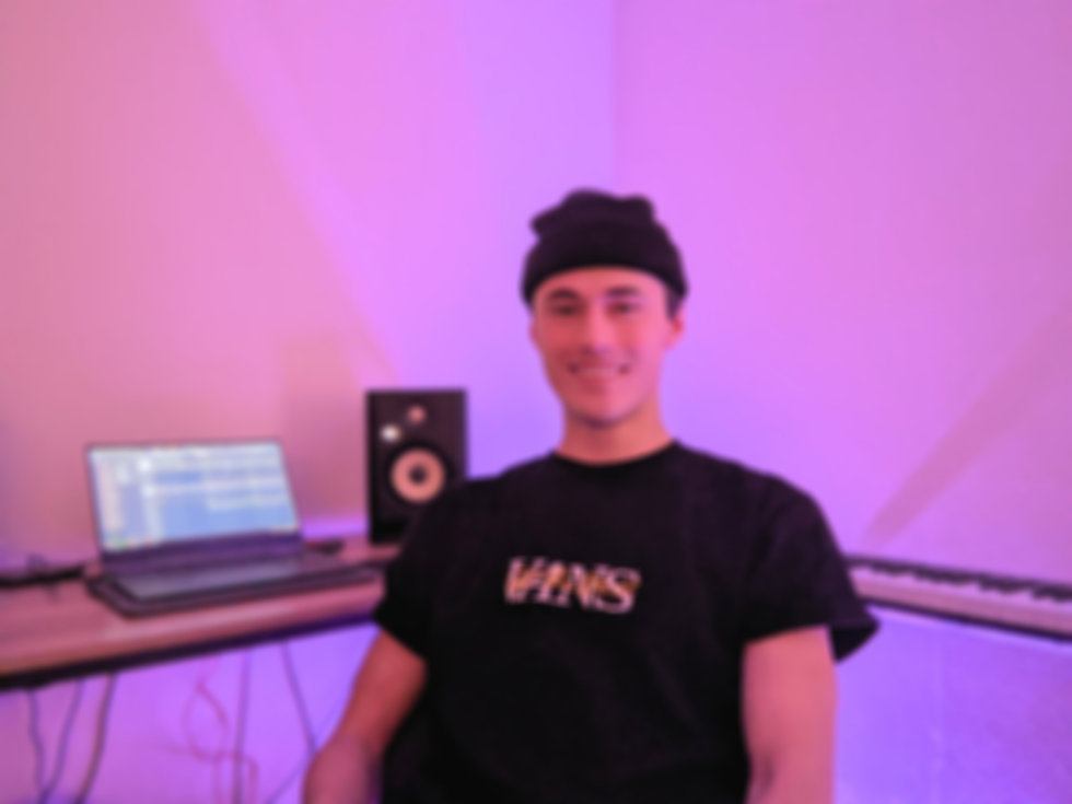 Sam, one of Utah's highest rated producers, shown producing music in his home studio.