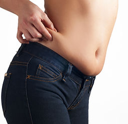 Woman checks and pinching Excess fat on