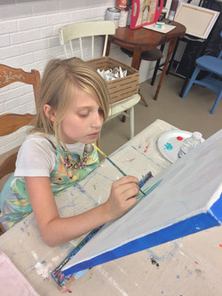 Allie painting a masterpiece.