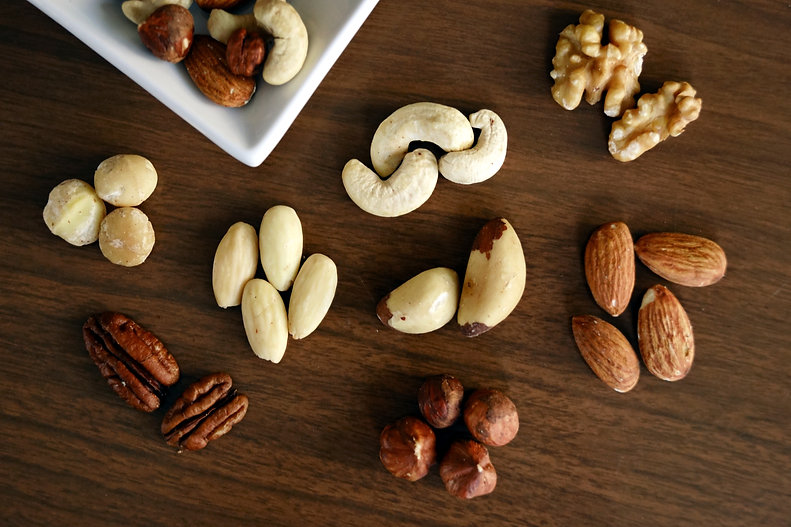 variety-of-brown-nuts-on-brown-wooden-pa