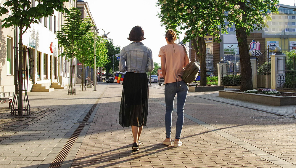 2 women walking and talking