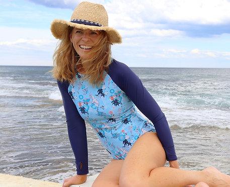 Shy Skin Dixon UPF 50+ Long Sleeve Swimsuit in Waterbird with Raffia Fringed Panama Hat