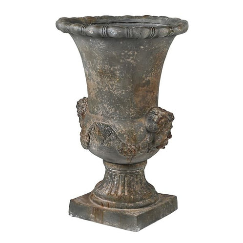 Distressed urn with heads and rope
